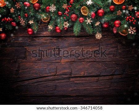 Christmas fir tree with decoration on a wooden board. Copyspace for text
