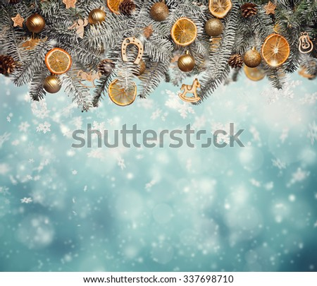 Christmas fir tree with decoration on blur shiny background