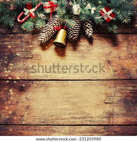 Christmas fir tree with decoration on dark wooden board - stock photo