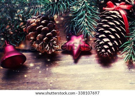 Christmas fir tree with decoration on dark wooden board in vintage style macro top view