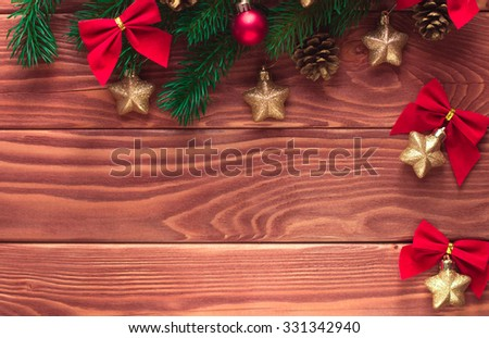 Christmas fir tree with decoration on dark wooden board. Soft focus. Happy New Year! - stock photo