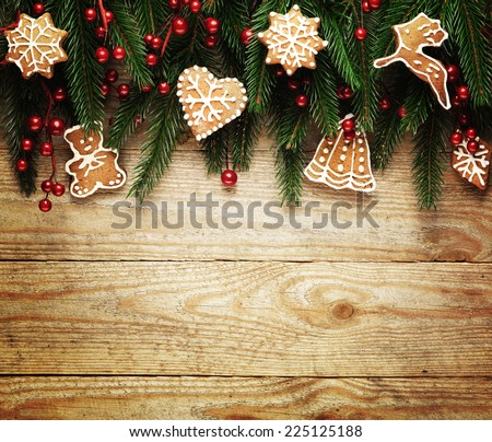 Christmas fir tree with decoration with cookies on a wooden board - stock photo