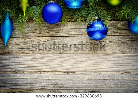 Christmas fir tree with decorations on an old wooden board, copy space for text, top view.
