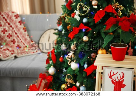 Christmas fir tree with gifts in living room