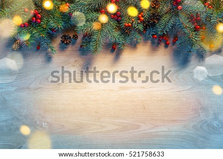 Christmas fir tree with lights on wooden background. Merry Christmas and Happy New Year!! Top view.