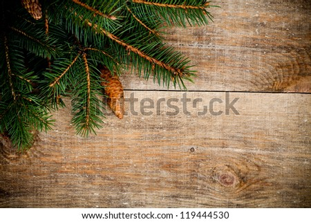 christmas fir tree with pinecones on a wooden board - stock photo