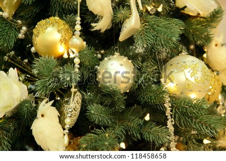 Christmas fir tree with white ornaments of close up