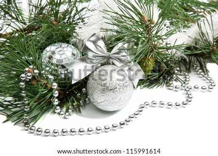 Christmas firtree branch with silver balls, beads and ribbon