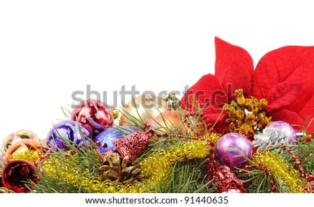 Christmas flower poinsettia with xmas colorful balls  and other decor - stock photo