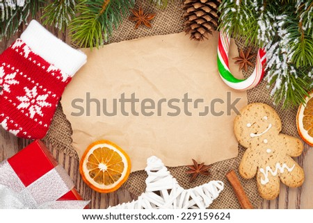 Christmas food and decor with snow fir tree background with paper for copy space - stock photo