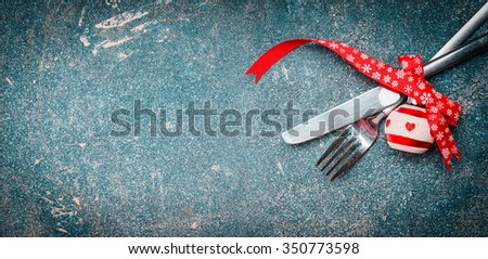 Christmas food background with table place setting: fork, knife and festive decoration, banner - stock photo