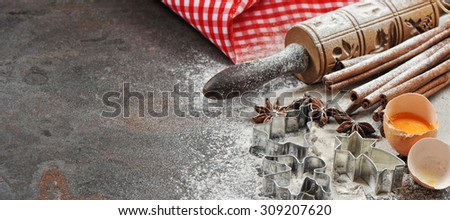 Christmas food. Baking ingredients and tolls for dough preparation. Flour, eggs, rolling pin and cookie cutters - stock photo