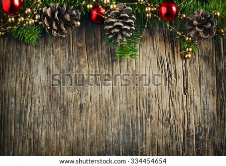 Christmas frame. Christmas fir branches on wooden background with copy space - stock photo