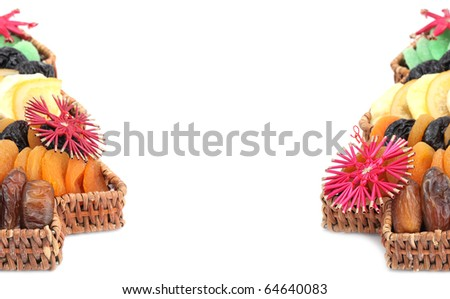 Christmas frame made of Christmas tree shaped basket with variety of dried fruits. Isolated on white background, shallow dof - stock photo