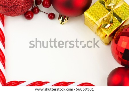 Christmas frame of red baubles and golden gift isolated on white - stock photo