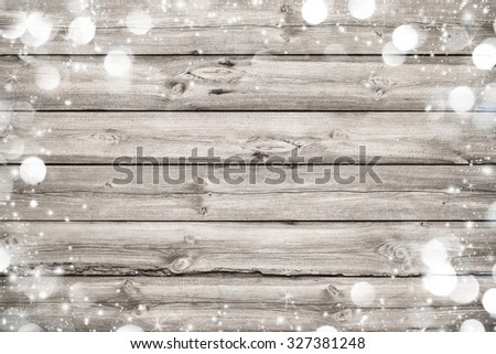 Christmas frame on wooden background with snow and lights - stock photo