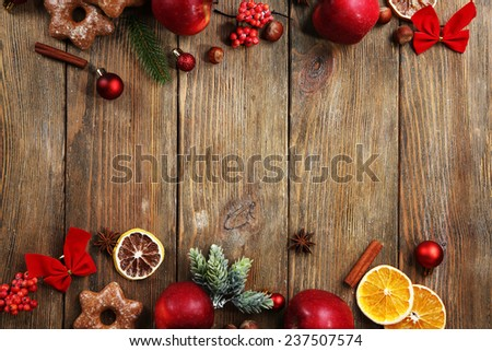 Christmas frame with apples and cookies on wooden table - stock photo