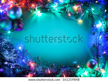 Christmas frame with fir, baubles and fairy lights. - stock photo