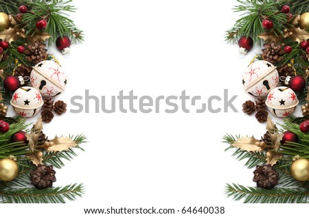 Christmas frame with jingle bells and other Christmas ornaments and decorations isolated on white. Shallow dof