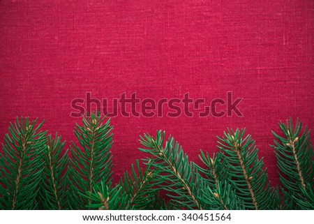 Christmas frame with xmas tree on red canvas background. Merry christmas card. Winter holidays. Xmas theme. Space for text. Happy New Year. - stock photo