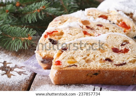 Christmas fruit bread Stollen close-up on the table. horizontal, rustic style  - stock photo