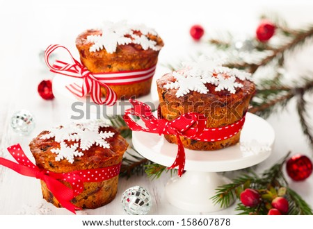 Christmas fruit cakes  with sugar snowflakes - stock photo