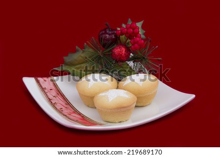 Christmas Fruit Mince Pies on Plate on Red - stock photo