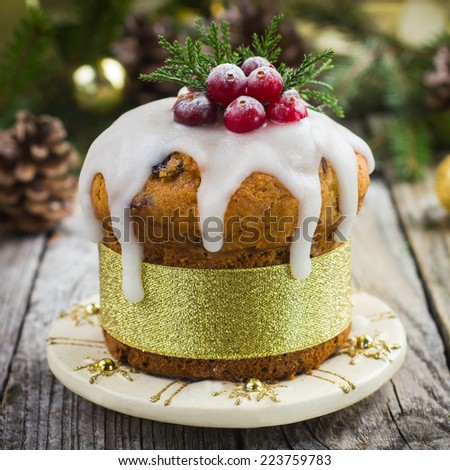 Christmas fruitcake decorated with icing and berries, square image