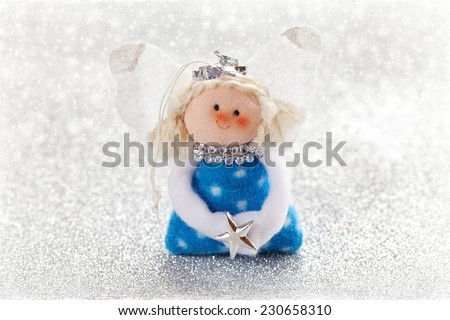 Christmas fun decorative toy on a snowy background .Christmas card.  - stock photo