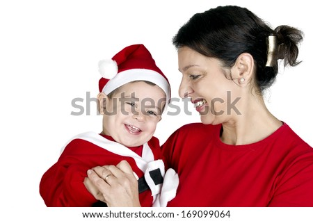 Christmas funny small kid in Santa Claus clothes with his grandmother - stock photo