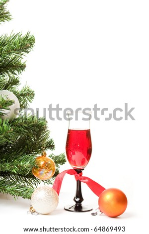 Christmas fur-tree with a glass of wine and an ornament on a white background for a card