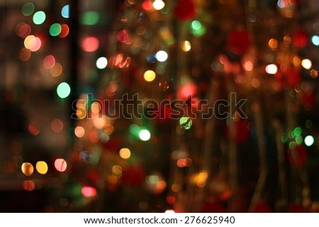 Christmas garland blurred lights of various colors. - stock photo