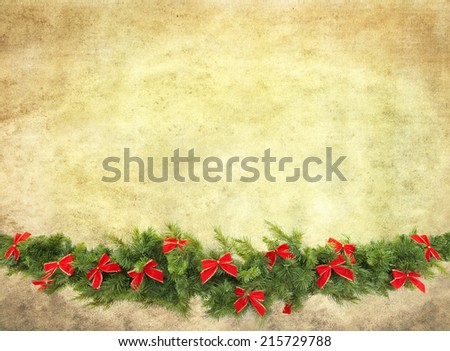 Christmas garland decorated with red velvet bows, isolated on white. - stock photo