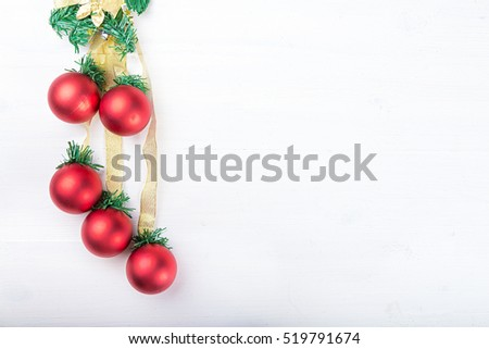 Christmas garland with toys red balls on white background, with space for text