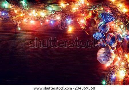 Christmas garlands of lamps on a wooden background. Frame of Christmas lights - stock photo
