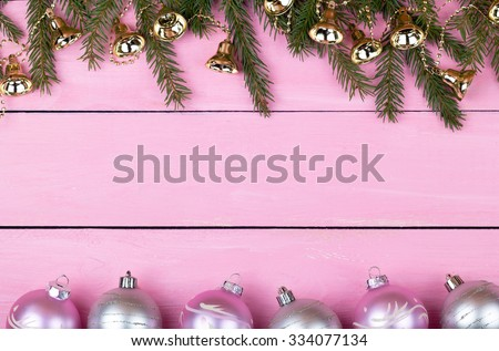 Christmas garlands on a pink wooden background with a place for your text - stock photo