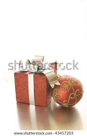 Christmas gift and ornament on silver background.