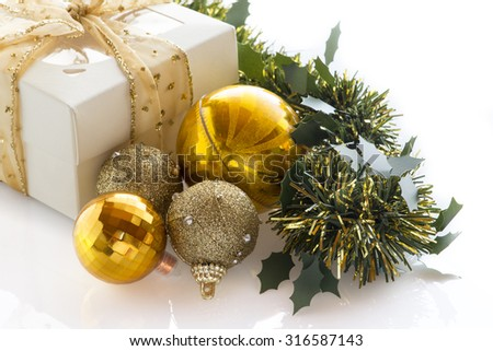 Christmas gift box, balls and fir tree. Isolated on white background with copy space