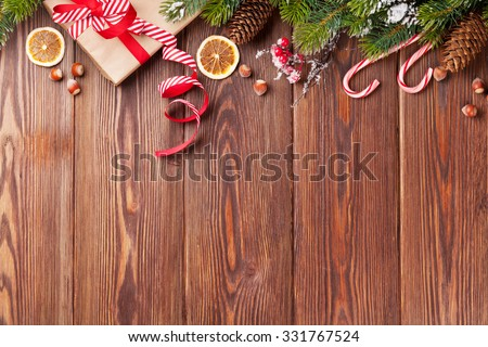 Christmas gift box, food decor and fir tree branch on wooden table. Top view with copy space - stock photo