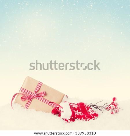 Christmas gift box in snow with background for copy space. Retro toned - stock photo