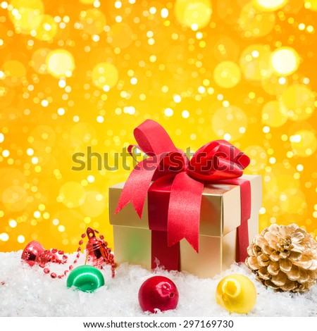 Christmas gift box in snow with bokeh background