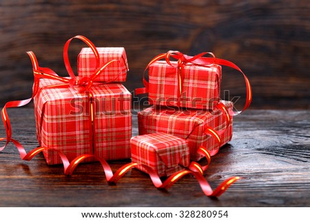 Christmas gift box on a wooden background