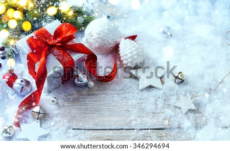 Christmas gift box on snow background and holidays light - stock photo