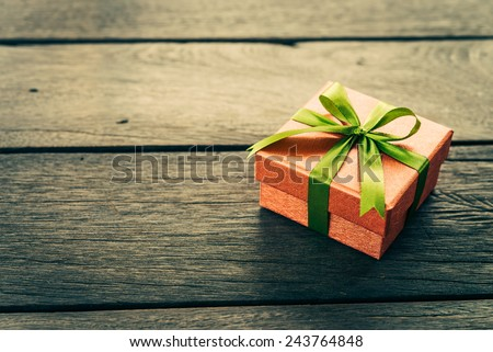 Christmas Gift box on wooden background - Vintage effect style pictures - stock photo
