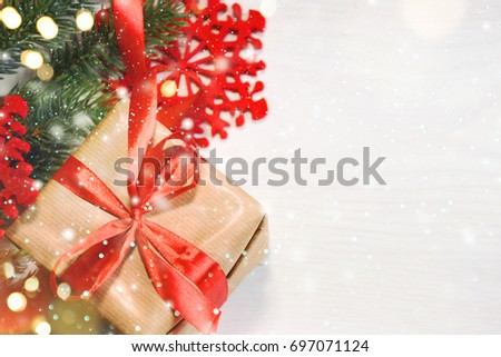 Christmas gift box on wooden background stock photo 731009389 christmas gift box on wooden background with snowflakes greeting card merry christmas and happy new negle Image collections