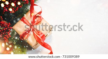 Christmas gift box on wooden background 731009389 christmas gift box on wooden background with snowflakes greeting card merry christmas and happy new negle Image collections