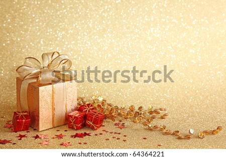 Christmas gift box on yellow background - stock photo