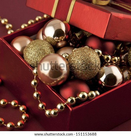 christmas gift box with balls and beads
