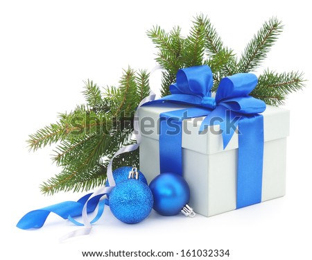 Christmas gift box with blue ribbon and fir branches. - stock photo