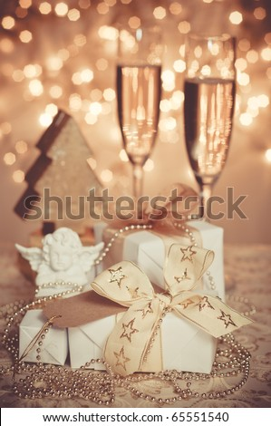 Christmas gift box with christmas angel and blank note - stock photo